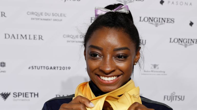 Simone Biles with the five gold medals she won at the 2019 World Artistic Gymnastics Championships