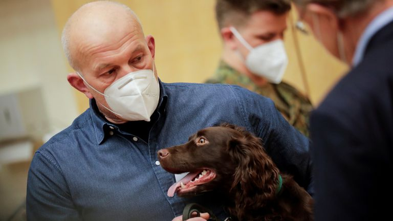 A researcher at Hanover university's vet clinic presents Joe, the 1-year-old Cocker Spaniel which is able to detect COVID-19 in humans' saliva samples, in Hanover, Germany, February 3, 2021. REUTERS/Hannibal Hanschke REFILE - CORRECTING YEAR.