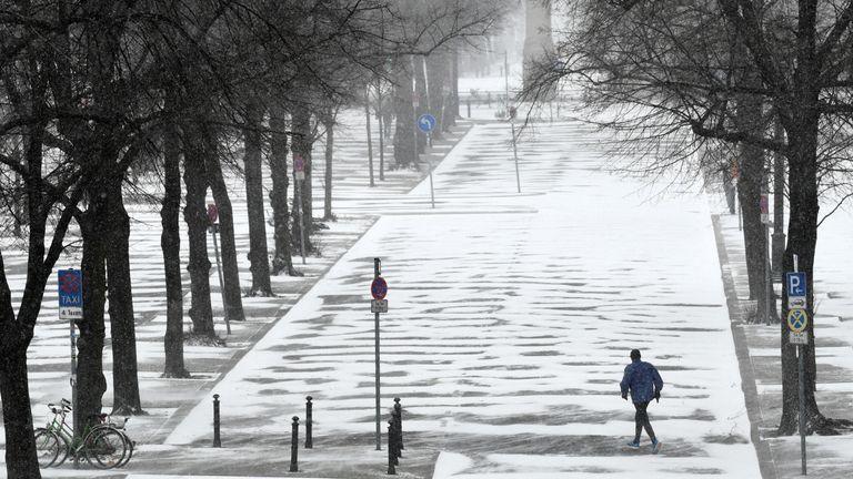 Someone goes jogging in a snowy Berlin