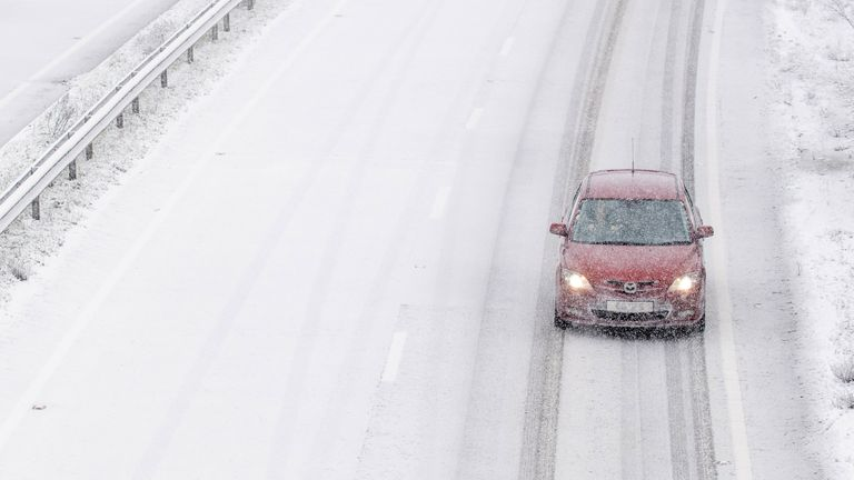 Snow falls on the A14 near Ipswich in Suffolk as Storm Darcy grips the nation
