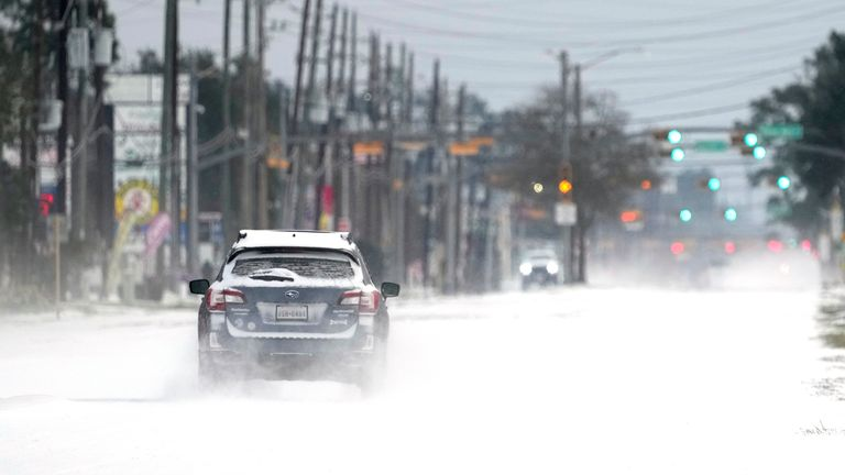 Vehicles drive on snow and sleet covered roads in Spring. Pic: Associated Press