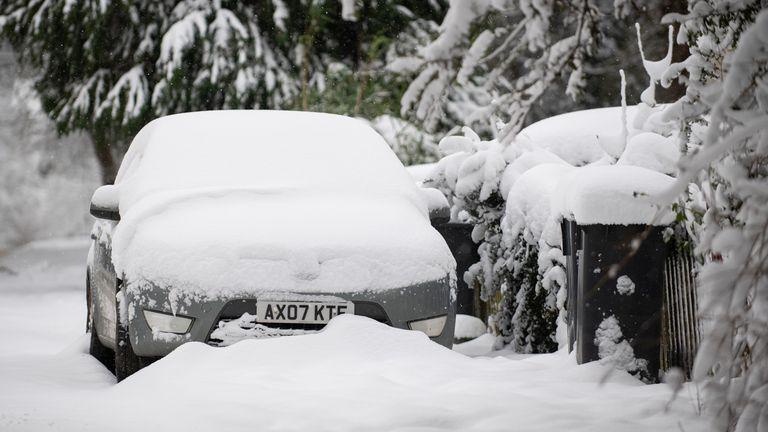 Snow covered cars in Barham near Ipswich