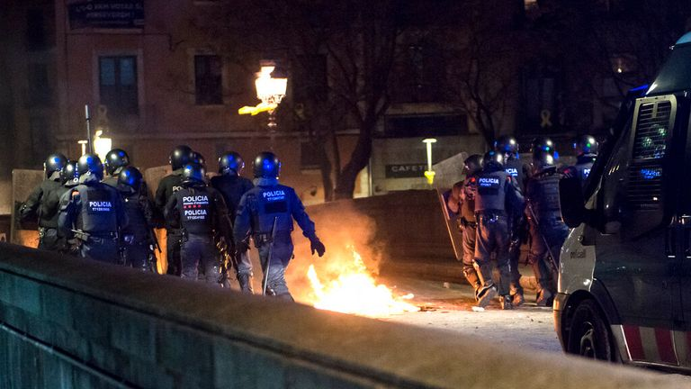 Police in riot gear have confronted demonstrators in Girona