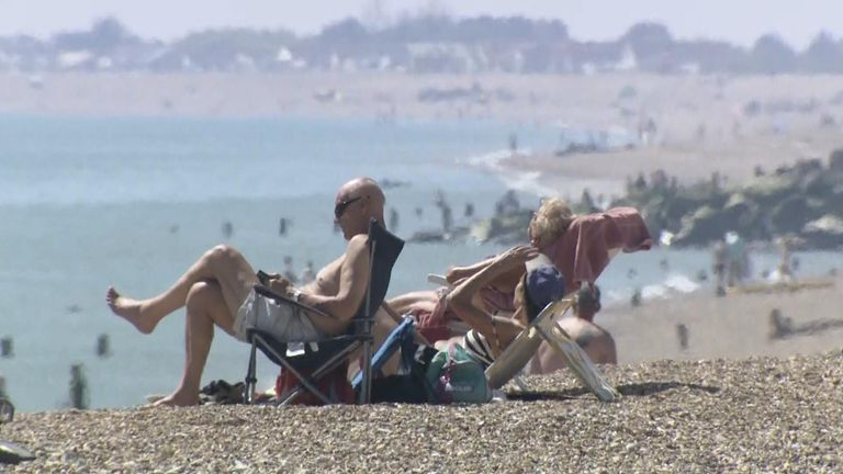 Beachgoers enjoy the sun in Bognor Regis