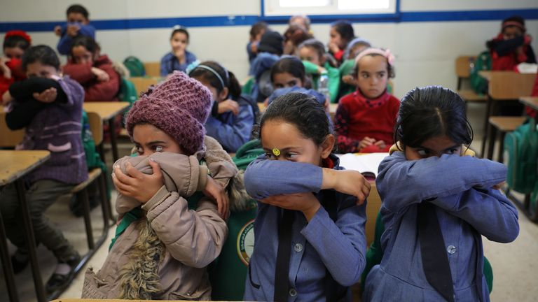 Syrian refugee children at a camp in Jordan get a lesson on hygiene during the pandemic