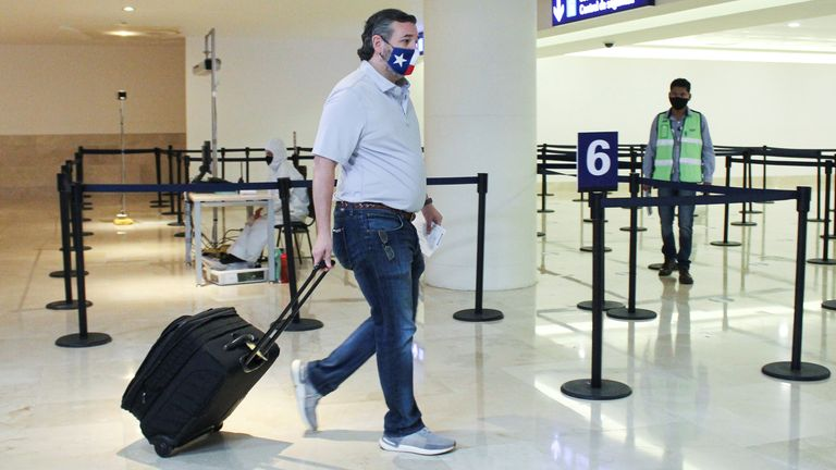 Ted Cruz at Cancun airport, Mexico, as he heads back to United States