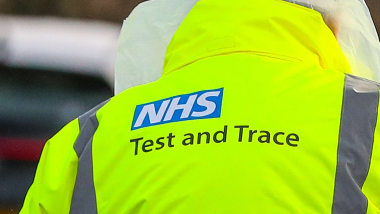 """An NHS Test and Trace worker hands a person a test kit in a drive through testing centre in Southport, Lancashire. A testing blitz of 80,000 people in England is aiming to find """"every single case"""" of the South Africa coronavirus variant in a bid to stop the spread of the more infectious strain. Picture date: Wednesday February 3, 2021."""