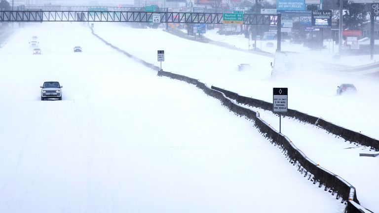 In this Feb. 15, 2021, file photo, traffic is sparse on the snow-covered Interstate 45 near The Woodlands Parkway following an overnight snowfall in The Woodlands, Texas. (Brett Coomer/Houston Chronicle via AP, File)