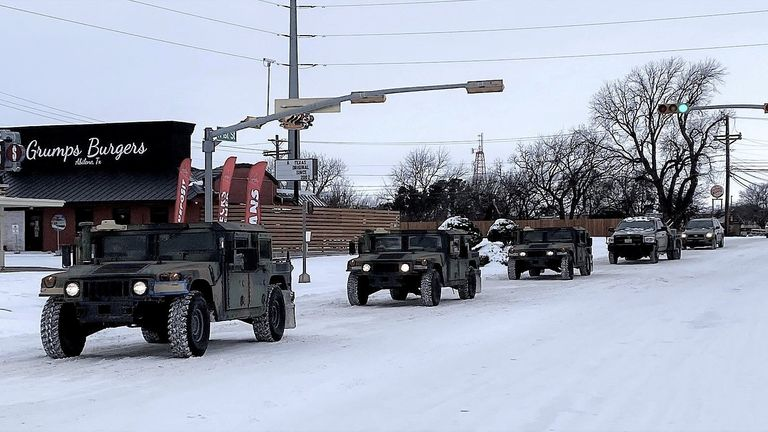 Military vehicles from the Texas Military Department of the Texas National Guard, tasked to transport residents to designated warming centers and other required duties, form a convoy in Abilene, Texas, U.S. February 16, 2021. Greg Jaklewicz/Reporter-News/USA Today Network via REUTERS. NO RESALES. NO ARCHIVES. MANDATORY CREDIT