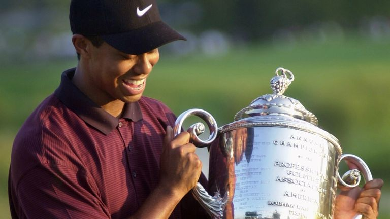 Woods holds up his trophy after winning the US PGA Championship