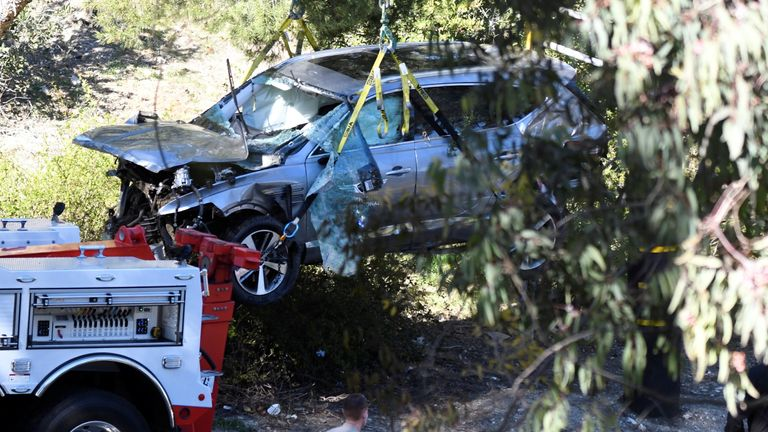 The golfer had to be pried from the car through the windscreen