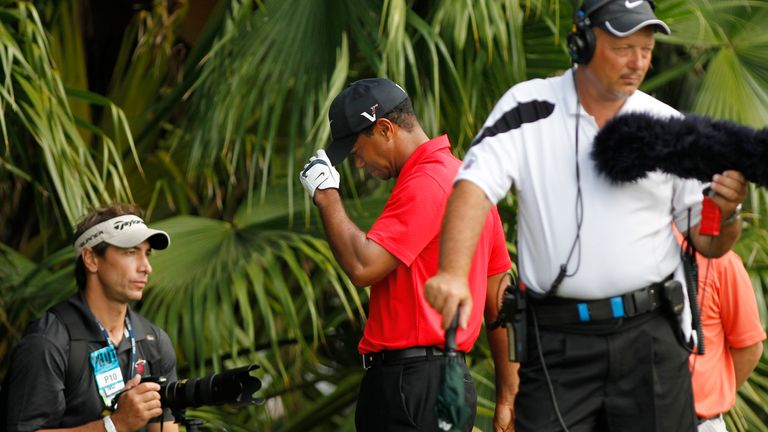 Woods walks off after withdrawing from the 2012 PGA Championship due to injury