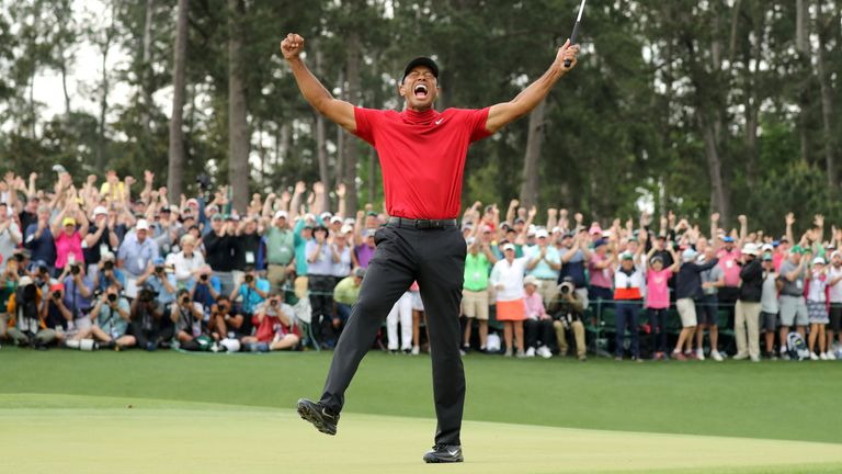 Golf - Masters - Augusta National Golf Club - Augusta, Georgia, U.S. - April 14, 2019. Tiger Woods of the U.S. celebrates on the 18th hole to win the 2019 Masters.
