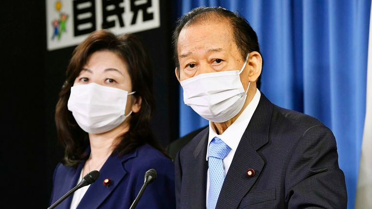 Toshihiro Nikai (R), secretary general of Japan's ruling Liberal Democratic Party, and Seiko Noda, the LDP's executive acting secretary general