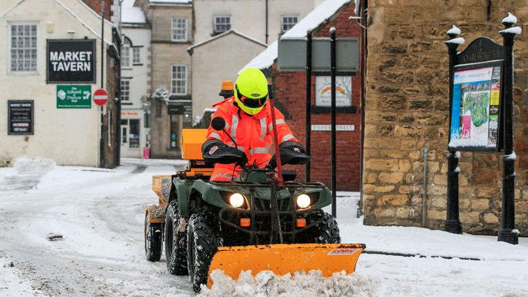 A council worker tries to clear snow in Bowes, County Durham