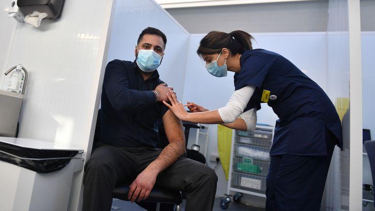 Pharmacist Josh Athwal receives his vaccine