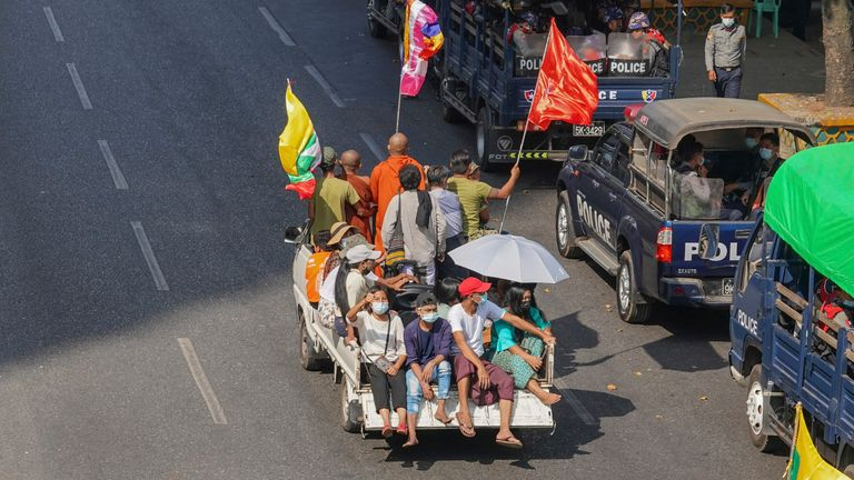 A vehicle carries supporters of the military in Myanmar. Pic: AP