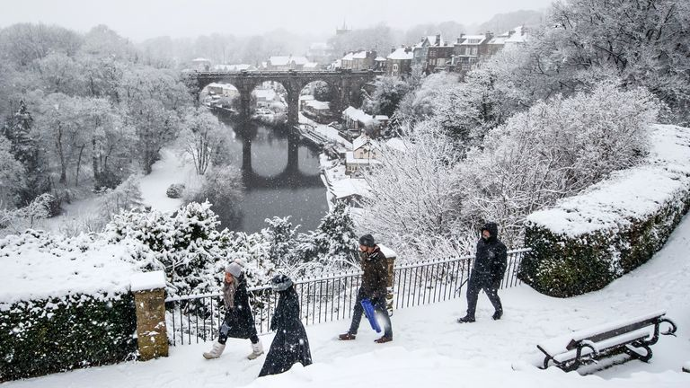 People walk near Knaresborough Viaduct in Knaresborough, North Yorkshire after snow fell overnight. Picture date: Tuesday February 2, 2021.