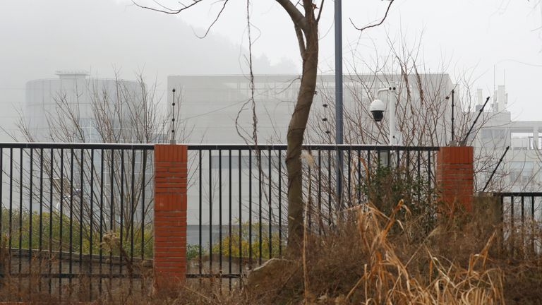 The P4 laboratory of Wuhan Institute of Virology is seen behind a fence during the visit by the World Health Organization (WHO) team tasked with investigating the origins of the coronavirus disease (COVID-19), in Wuhan, Hubei province, China February 3, 2021.