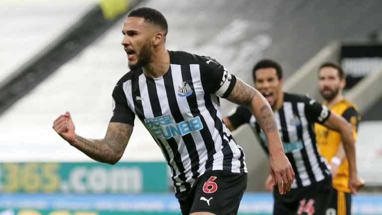 Jamaal Lascelles celebrates after heading Newcastle in front against Wolves