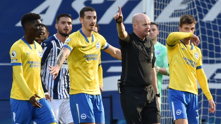 Referee Lee Mason appears to award Brighton a goal that was initially disallowed