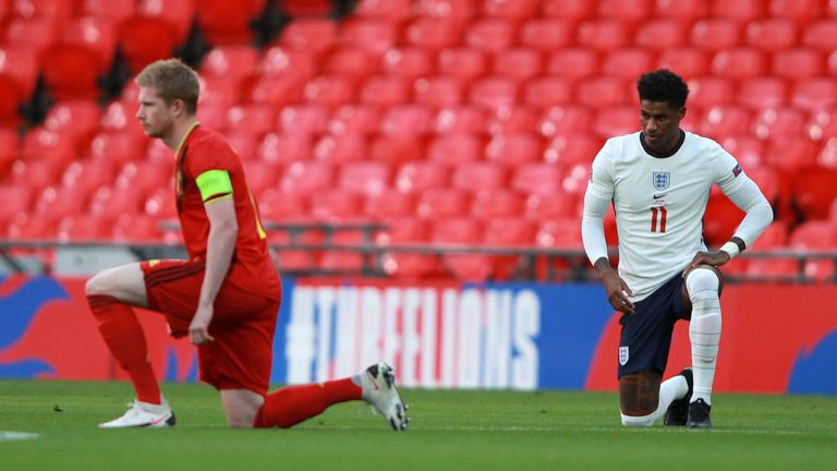 Belgium's Kevin De Bruyne, left, and England's Marcus Rashford take the knee before their UEFA Nations League match