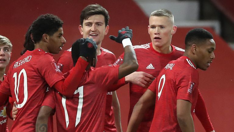 Scott McTominay celebrates with team-mates after giving Man Utd an extra-time lead against West Ham