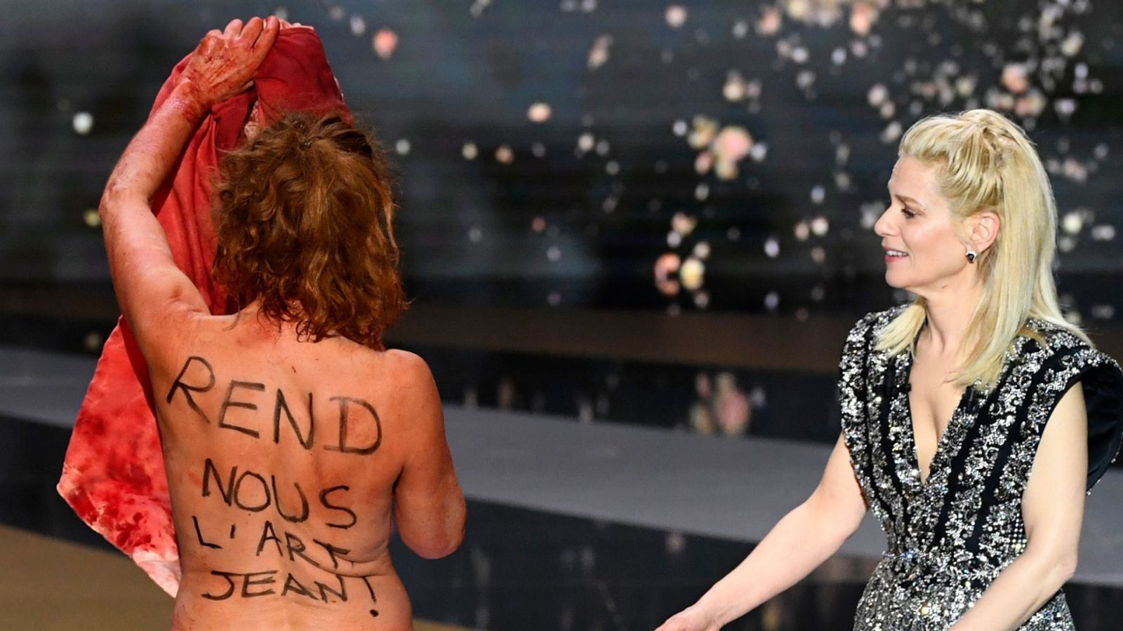 Actress Corinne Masiero protests naked at French Oscars
