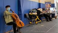 Vaccine recipients were treated to a mini concert when famed cellist Yo-Yo Ma brought out his instrument after getting his jab.