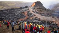 People gather at the volcanic site on the Reykjanes Peninsula in Iceland