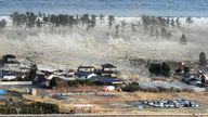 TOKYO, Japan - A massive tsunami engulfs a residential area after a powerful earthquake in Natori, Miyagi Prefecture, northeastern Japan, on March 11, 2011. (Kyodo via AP Images)