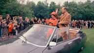 Britain's Queen Elizabeth II, with her husband Prince Philip, in an open topped car as they leave an event, in Paris, on May 16, 1972. The Queen is on a four day official visit to France. (AP Photo)