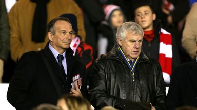Leeds United Sporting Director Nicola Salerno (left) and former player Peter Lorimer in the stands