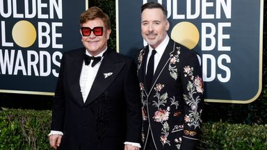 Elton John and David Furnish at the Golden Globes in 2020. Pic: AP