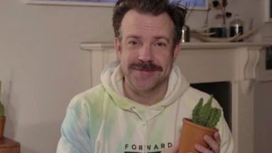 Jason Sudeikis holds a plant at the Golden Globe Awards. Pic: AP