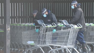 Police examine trolleys at a Co-op in Sandwich, Kent