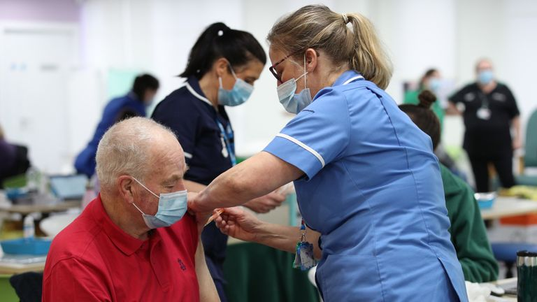 Silja Mai (right), Immunisation Nurse, gives Ron Mees, aged 69, a dose of the Oxford/Astra Zeneca Covid-19 vaccine, during a mass vaccination of members of the public at Robertson House, Stevenage. Picture date: Tuesday February 9, 2021.