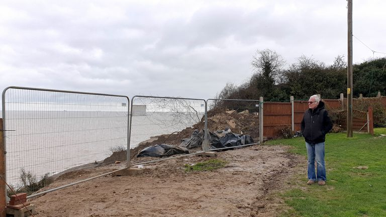 Edd Cane, stands in his garden which now sits next to the cliff edge in Eastchurch, on the Isle of Sheppey, Kent, where residents continue to find a way to save their homes from plunging over the cliff edge. Picture date: Thursday March 4, 2021. Picture date: Thursday March 4, 2021.