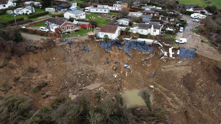 The home (left) of Edd Cane, on the cliff edge in Eastchurch, on the Isle of Sheppey, Kent, where residents continue to find a way to save their homes from plunging over the cliff edge. Picture date: Thursday March 4, 2021. Picture date: Thursday March 4, 2021.