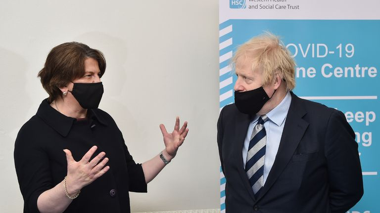 Prime Minister Boris Johnson speaks with First Minister Arlene Foster during a visit to the Lakeland Forum vaccination centre in Enniskillen, Northern Ireland. Picture date: Friday March 12, 2021.