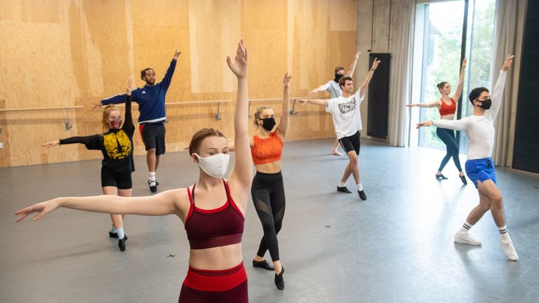 Students observe social distancing as they take part in a dance session as classes resume at Mountview Academy of Theatre Arts drama school in Peckham, south London, following its closure due to coronavirus.