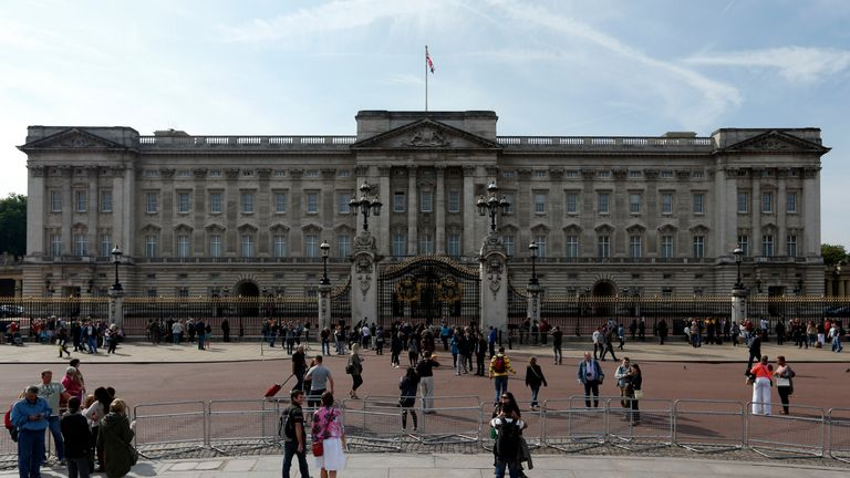 Tourists outside Buckingham Palace, central London.