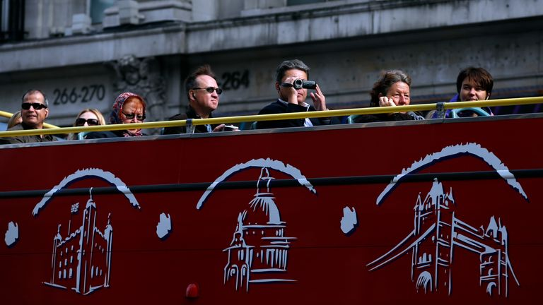 Tourists on a bus tour in central London.