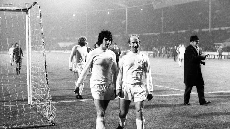 File photo dated 3-01-1973 of (L-R) Peter Lorimer and Bobby Charlton walk off the field after the match finishes. Issue date: Friday February 26, 2021.