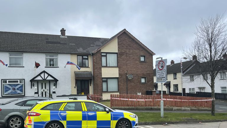The scene at a residential property in the Derrycoole Way, Newtownabbey, after police launched a murder investigation after three bodies were found at separate properties. Picture date: Saturday March 20, 2021.