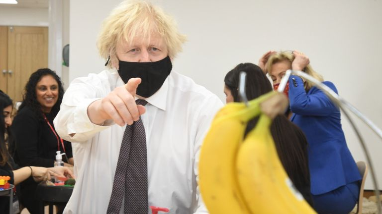 Prime Minister Boris Johnson drawing a bunch of bananas during a visit to the Monkey Puzzle Nursery in Greenford, west London. Picture date: Thursday March 25, 2021.