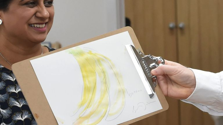 Prime Minister Boris Johnson shows his drawing of a bunch of bananas during a visit to the Monkey Puzzle Nursery in Greenford, west London. Picture date: Thursday March 25, 2021.