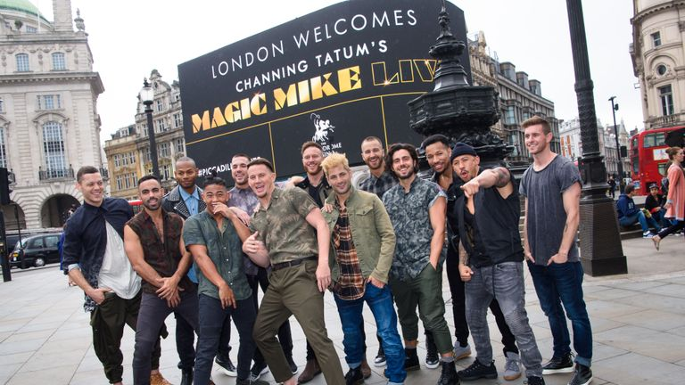 Channing Tatum pictured with dancers from Magic Mike Live in Piccadilly Circus, London, as the giant screens welcome the show to the capital.