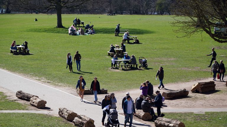 People meet and walk the grounds at Wollaton Hall, Nottingham, on the first day of the easing of England's lockdown restrictions allowing people to mix outdoors. Picture date: Monday March 29, 2021.