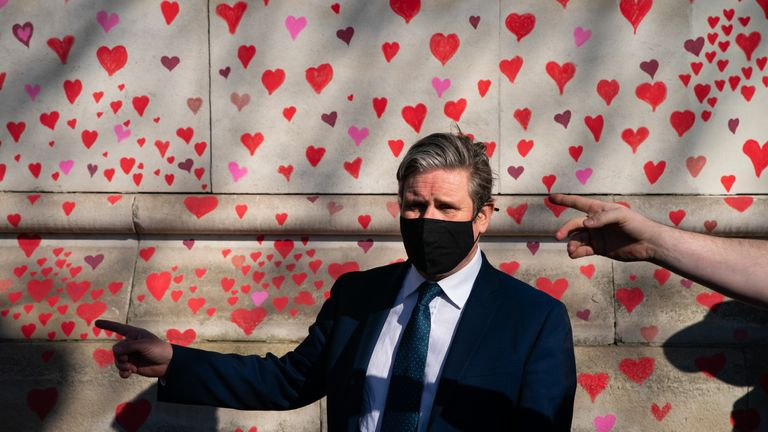 Labour Party leader Keir Starmer visits the COVID-19 Memorial Wall on the Embankment, central London, which has been painted with hearts in memory of the more than 145,000 people who have died in the UK from coronavirus. Picture date: Monday March 29, 2021.
